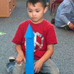 Little boy playing on shape blocks